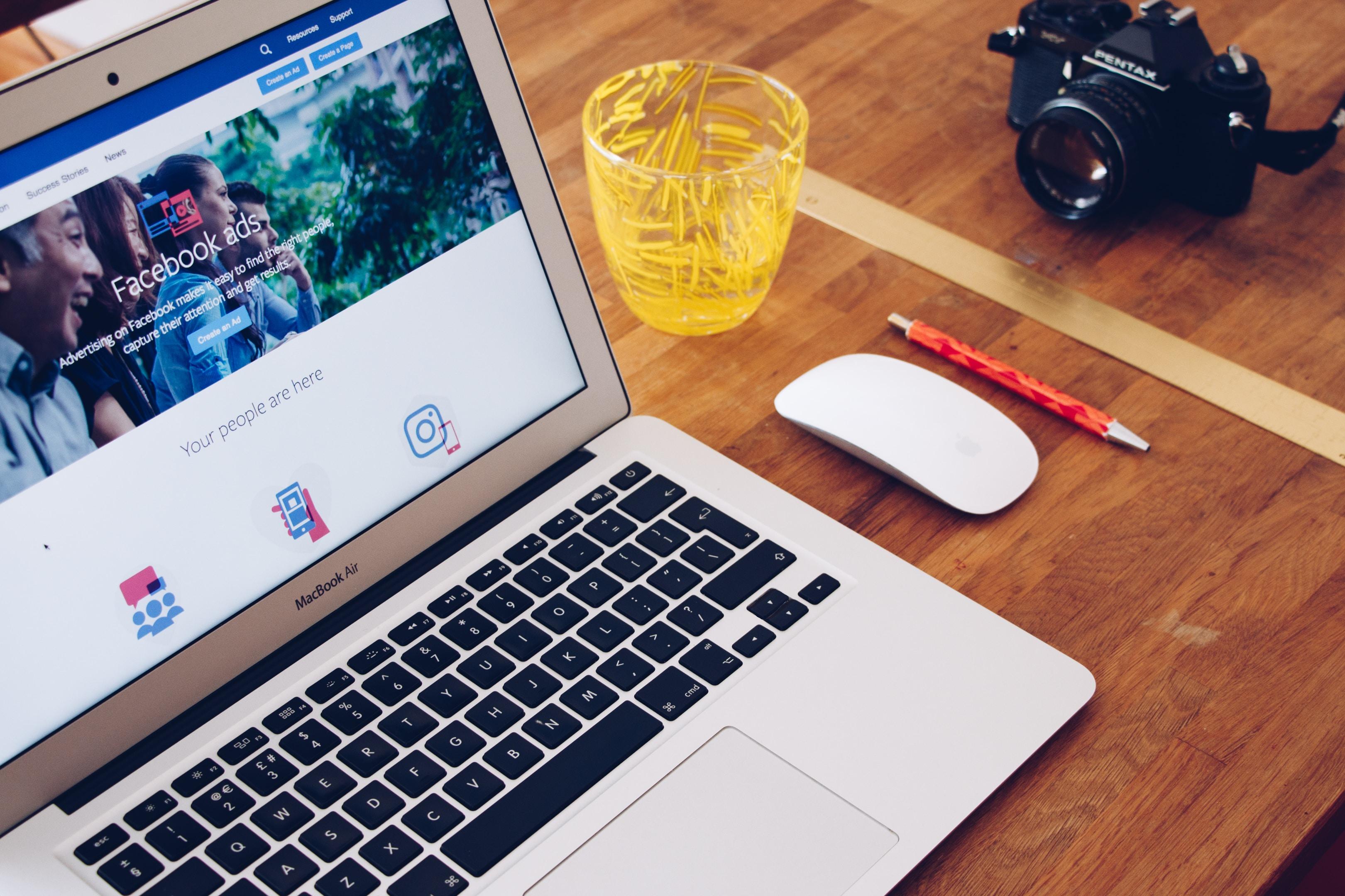 financial advisor facebook ads computer with facebook open